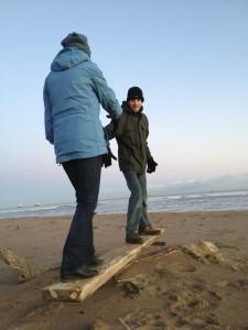 Matthew and Joan on beach seesaw