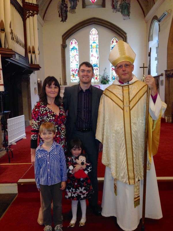 Wesley and family with the Bishop of Bradbury
