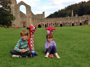 Alex and Emily with scooters at Fountain Abbey
