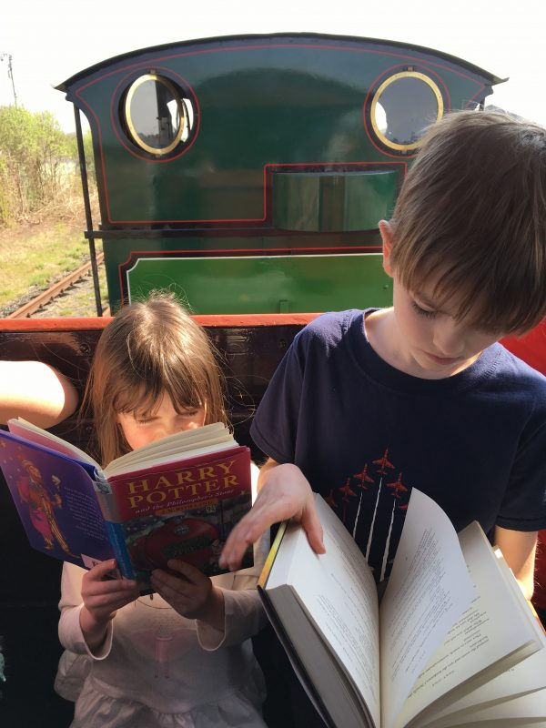 Alex and Emily reading on a train