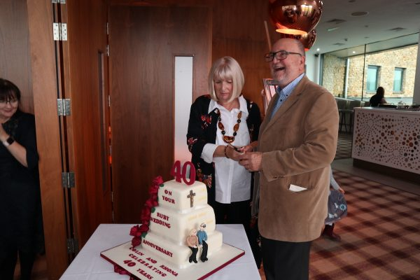 Colin and Rhona Stanbury cutting their 40th anniversary cake