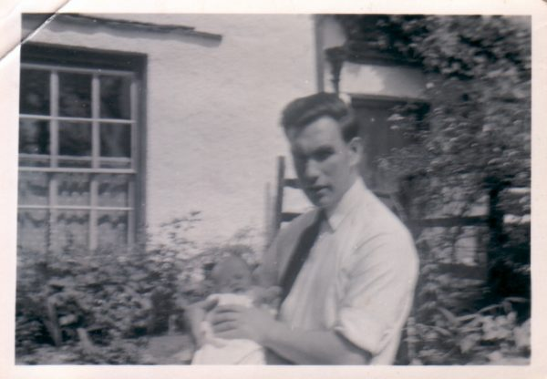 Baby Barrie and his father, Deb, outside Rose Cottage in Elterwater