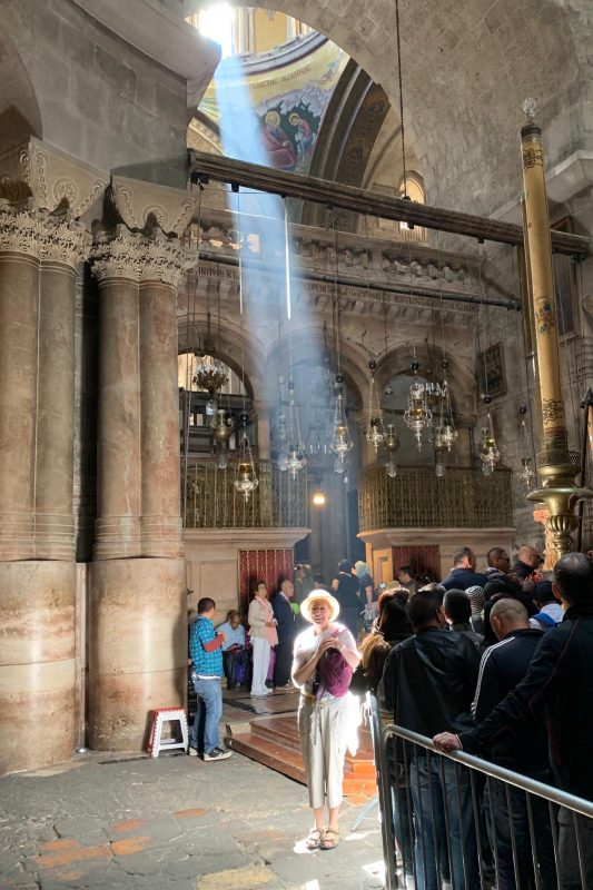 Joan in a shaft of light inside the church of the Holy Sepulchre